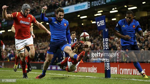 Liam Williams of Wales narrowly misses scoring a try as Maxime Medard of France clears the ball during the RBS Six Nations match between Wales and...
