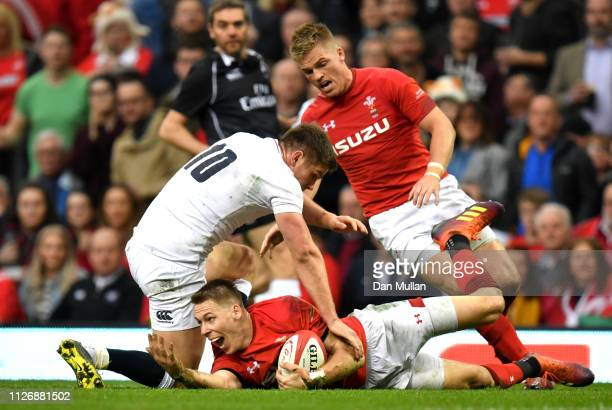 Liam Williams of Wales reacts after being tackled by Owen Farrell of England during the Guinness Six Nations match between Wales and England at...