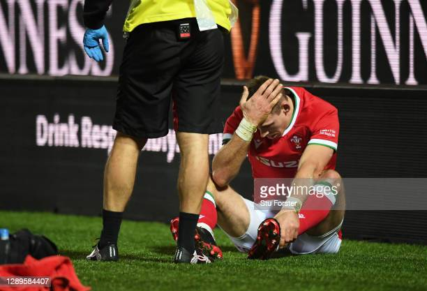 Liam Williams of Wales reacts as he is forced to leave the field with an injury during the Autumn Nations Cup match between Wales and Italy at Parc y...