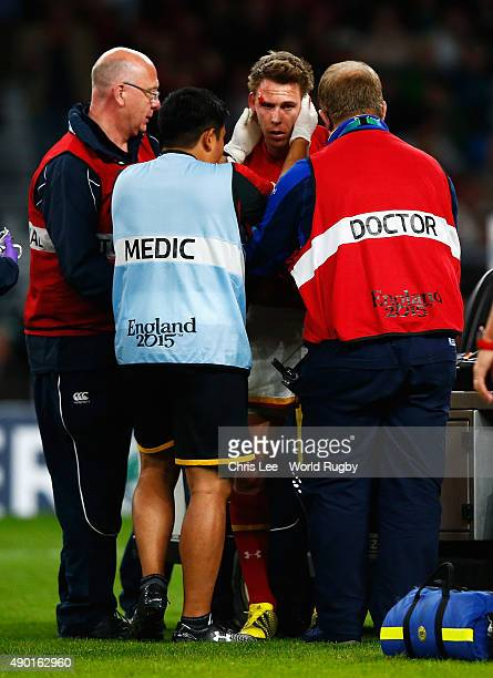Liam Williams of Wales receives medical attention during the 2015 Rugby World Cup Pool A match between England and Wales at Twickenham Stadium on...