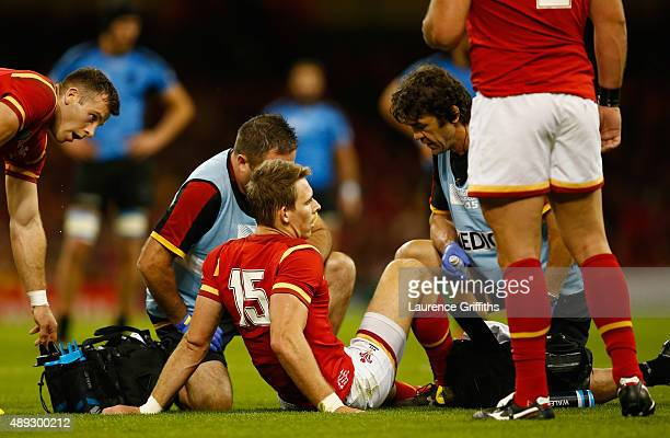 Liam Williams of Wales receives treatment on his injury during the 2015 Rugby World Cup Pool A match between Wales and Uruguay at Millennium Stadium...