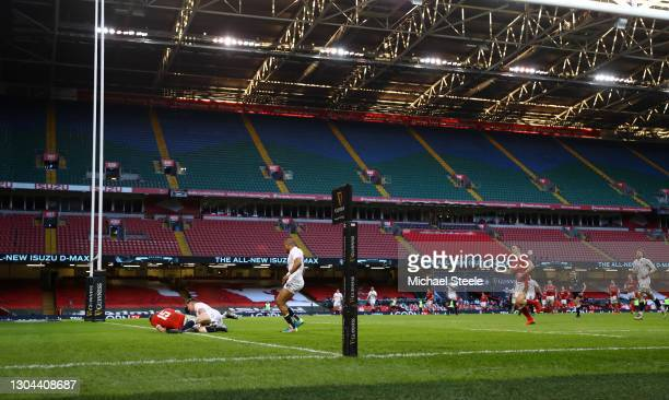 Liam Williams of Wales scores their side's second try as Owen Farrell of England tackles during the Guinness Six Nations match between Wales and...