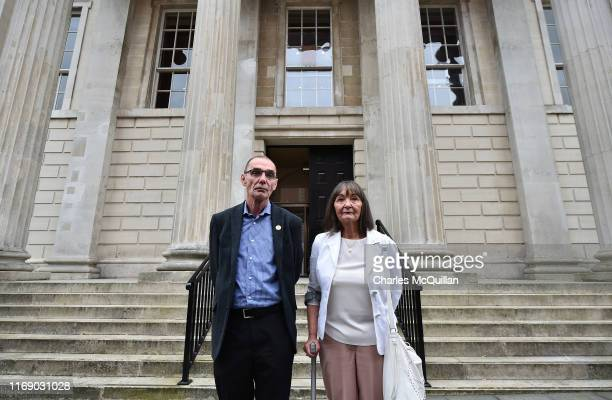 Liam Wray brother of Bloody Sunday victim James Wray and sister Margaret Wray stand outside Derry Courthouse as the first listing of the case against...