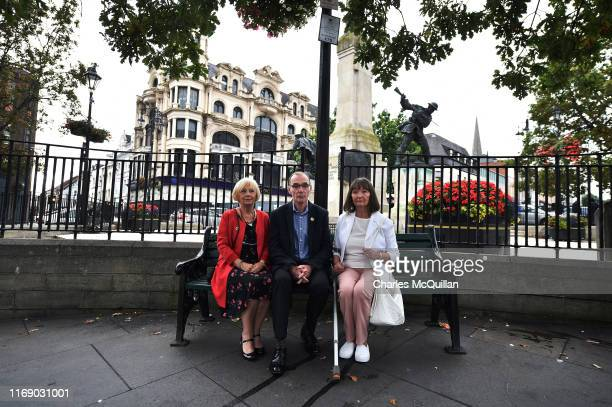 Liam Wray brother of Bloody Sunday victim James Wray sister Margaret Wray and Doreen Wray gather with other relatives near Derry Courthouse as the...