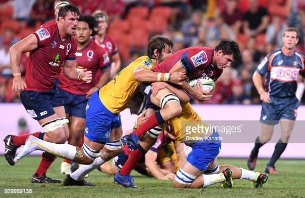 Liam Wright of the Reds takes on the defence during the round four Super Rugby match between the Reds and the Bulls at Suncorp Stadium on March 10...