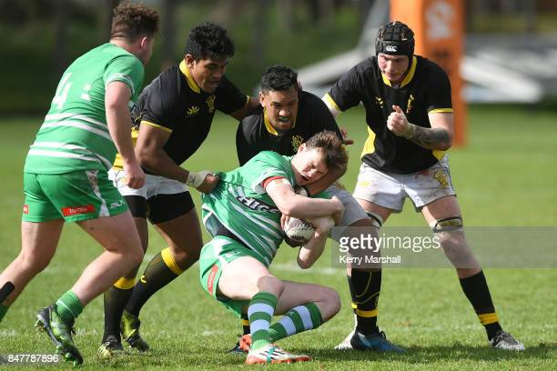 Liam Younger of Manawatu is dragged backwards by Wellingtonduring the Jock Hobbs Memorial Tournament match between Wellington and Manawatu on...