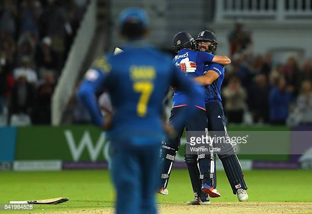 Lian Plunkett of England is congratulated by team mate Chris Woakes after hitting a a six off the last ball the tie the 1st ODI Royal London One Day...