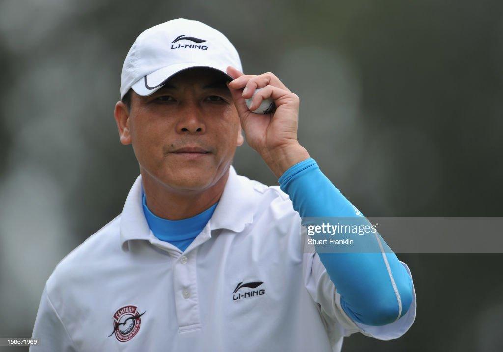 Lian - Wei Zhang of China ponders during the third round of the UBS Hong Kong open at The Hong Kong Golf Club on November 17, 2012 in Hong Kong, Hong Kong.