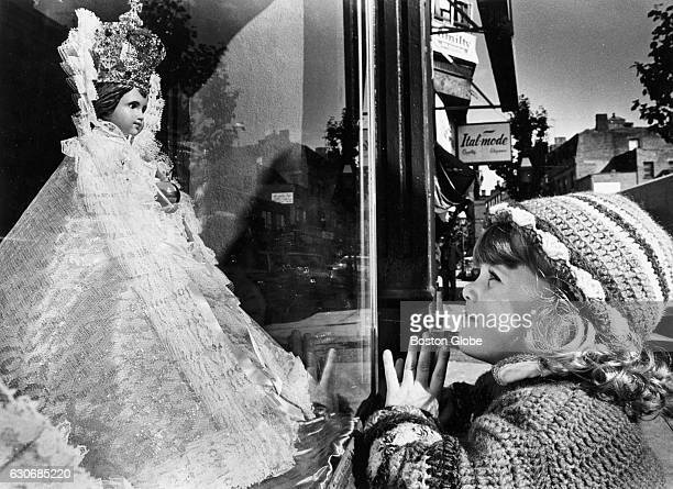 Liana DiSchino of Lynnfield Mass admires a statuette in the window of Hanover Street shop in Boston's North End on Oct 21 1980