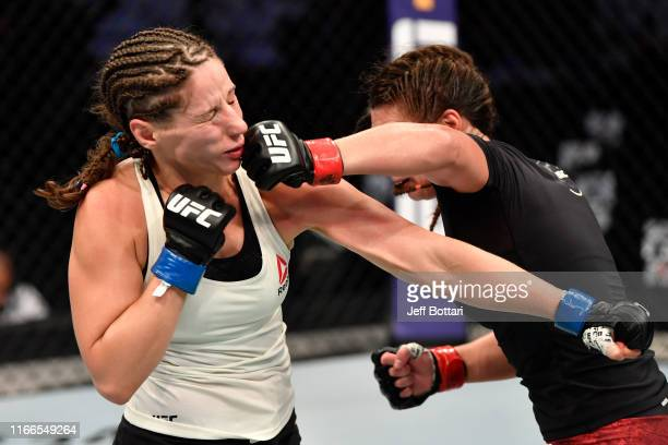 Liana Jojua of Georgia punches Sarah Moras of Canada in their women's bantamweight bout during UFC 242 at The Arena on September 7 2019 in Yas Island...