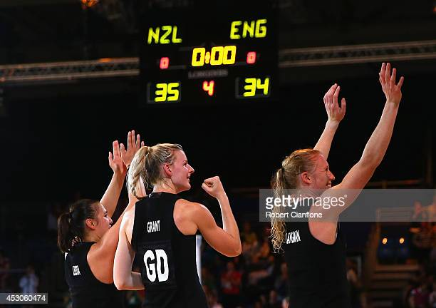 Liana Leota Katrina Grant and Laura Langman of New Zealand celebrate after New Zealand defeated England in the netball semi final between New Zealand...