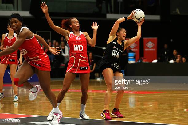 Liana Leota of New Zealand and Serena Guthrie of England fight for the ball the ball during the International netball Test match between the New...