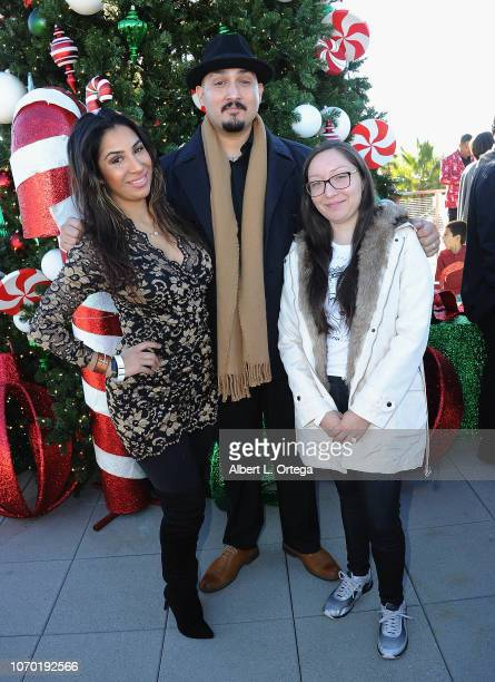 Liana Mendoza Adam Mendoza and Jamie Mendoza attend The 51st Annual Pacoima Holiday Parade on December 8 2018 in Pacoima California