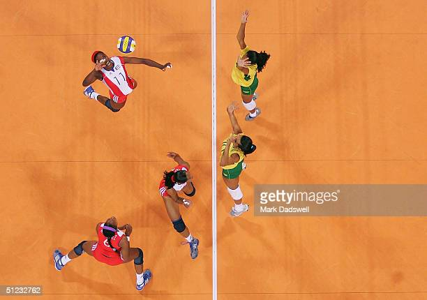 Liana Mesa Luaces of Cuba goes up for a spike against Brazil in the women's indoor Volleyball bronze medal match on August 28 2004 during the Athens...