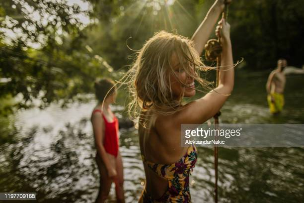 liana swing on the river - active lifestyle stock pictures, royalty-free photos & images