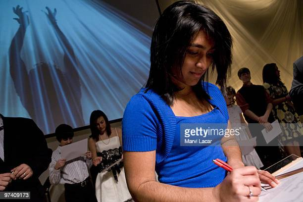 Liane Gazmeo 16 signs her 'True Love Waits' commitment certificate during a purity ring ceremony on February 13 2008 at the Full Life Assembly of God...