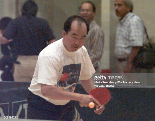 Liang Geliang who was at the first Stanford tournament 25 years ago warms up before he competes [970728 LO 1B PE 2] PING PONG 7/29 2bmo PHOTO BY L G...