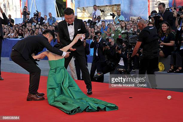 Liang Jingke falls on the red carpet of the premiere of 'The Light Between Oceans' during the 73rd Venice Film Festival at on September 1 2016 in...