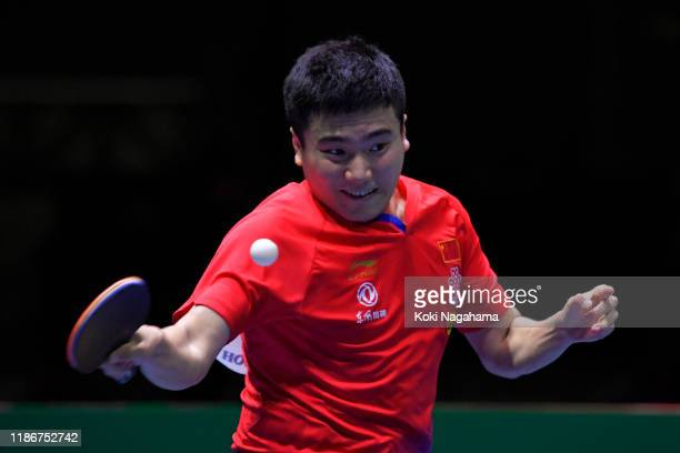 Liang Jingkun of China competes against Jeoung Youngsik of South Korea during match 1 of the men's team singles final on day five of the ITTF Team...