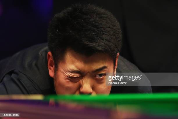 Liang Wenbo of China prepares to play a shot during his match against Judd Trump of Englandon day two of The Dafabet Masters at Alexandra Palace on...