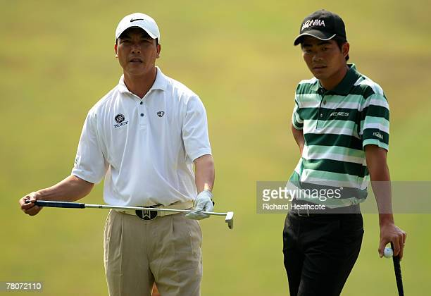 Liang WenChong and Zhang LianWei of China line up a putt on the 3rd green during the second round of the Omega Mission Hills World Cup at the Mission...
