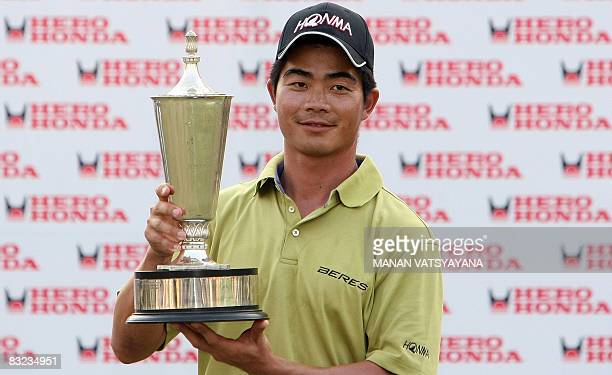 Liang Wen-chong if China poses with the trophy after winning the Hero Honda Indian Open at the Delhi Golf Club in New Delhi on October 12, 2008. AFP...