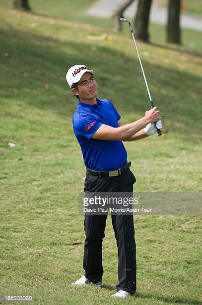 Liang Wenchong of China hits his approach shot to the 7th green during round two of the Venetian Macau Open on October 18 2013 at the Macau Golf...