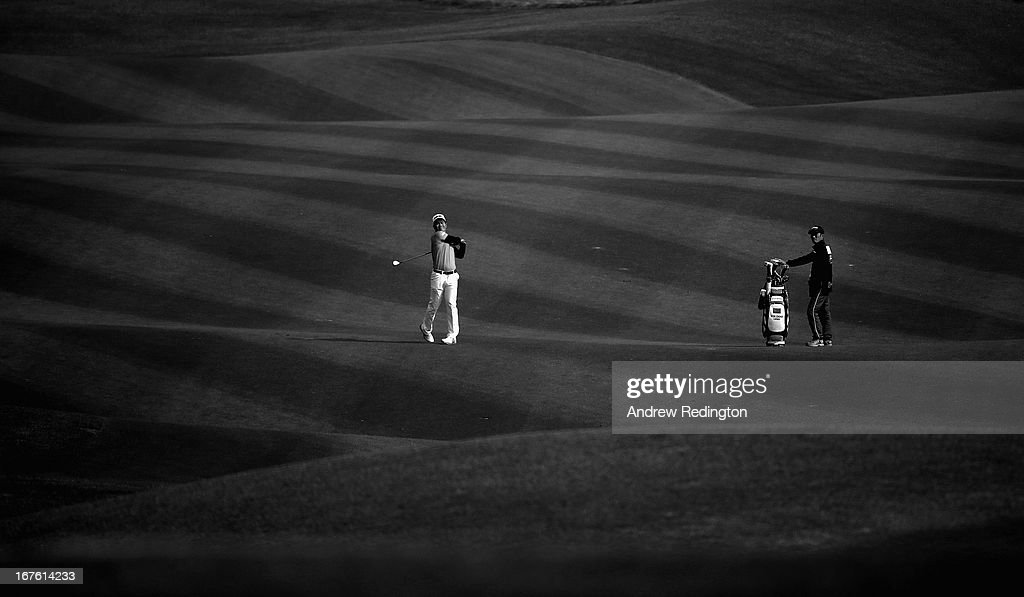 Liang Wen-chong of China plays his second shot on the 18th hole during the completion of the second round of the Ballantine's Championship at Blackstone Golf Club on April 27, 2013 in Icheon, South Korea.