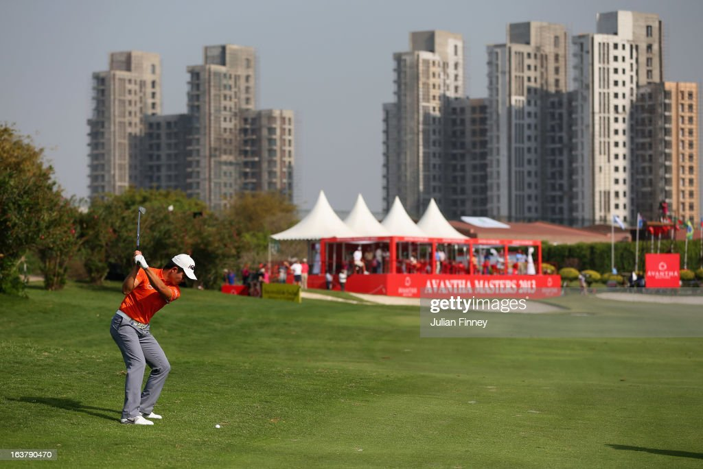 Liang Wenchong of China plays his second shot to the 18th green during day three of the Avantha Masters at Jaypee Greens Golf Club on March 16, 2013 in Delhi, India.