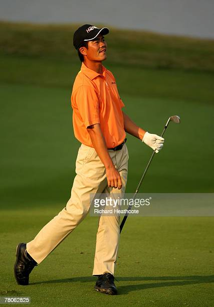 Liang WenChong of China plays into the 18th green during the first round of the Omega Mission Hills World Cup at the Mission Hills Resort on 22...