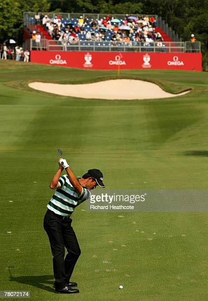 Liang WenChong of China plays into the 4th green during the second round of the Omega Mission Hills World Cup at the Mission Hills Resort on 23...