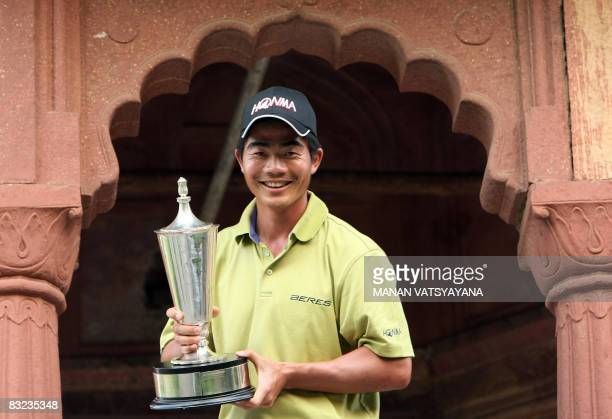 Liang Wenchong of China poses with the winner's trophy at the Hero Honda Indian Open at the Delhi Golf Club in New Delhi on October 12 2008 China's...