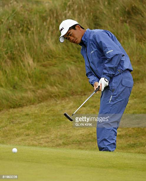 Liang WenChong of China putts on the 1st green during the first day of the British Open golf tournament at Royal Birkdale in Southport in northwest...