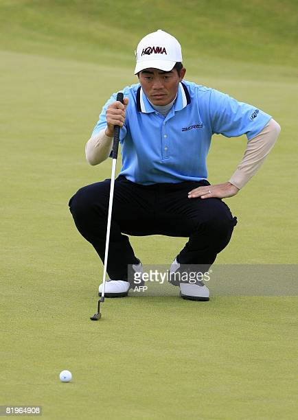 Liang Wenchong of China putts on the 2nd green during the first day of the British Open golf tournament at Royal Birkdale in Southport in northwest...