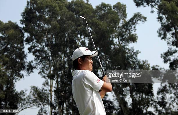 Liang WenChong of China watches his 2nd shot on the 7th hole during previews ahead of the USB Hong Kong Open at The Hong Kong Golf Club on November...