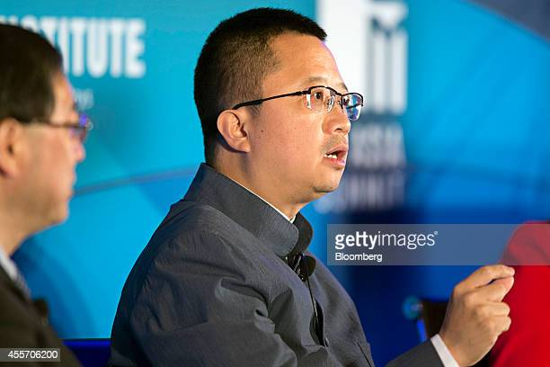 Liang Xinjun vice chairman and chief executive officer of Fosun International Ltd gestures as he speaks at the Milken Institute Asia Summit in...