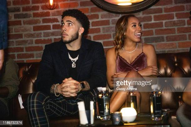LiAngelo Ball and girlfriend Jaden Owens sit together at his 21st Birthday Party at Argyle club on November 23, 2019 in Hollywood, California.