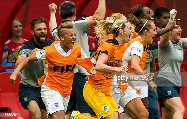 Lianne Sanderson and Carly Telford of England run onto the field to celebrate at the final whistle as England defeats Canada 21 in the FIFA Women's...