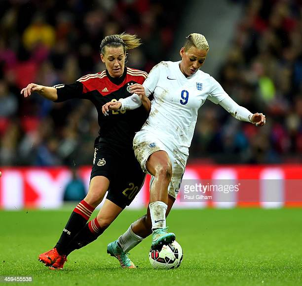 Lianne Sanderson of England ischallenged by Lena Goessling of Germany during the Women's International Friendly match between England and Germany at...