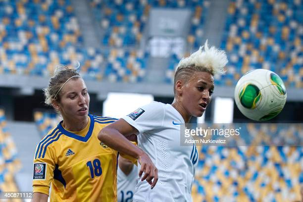 Lianne Sanderson of England Women fights for the ball with Iryna Vasylyuk of Ukraine Women during the FIFA Women's World Cup 2015 Qualifier match...