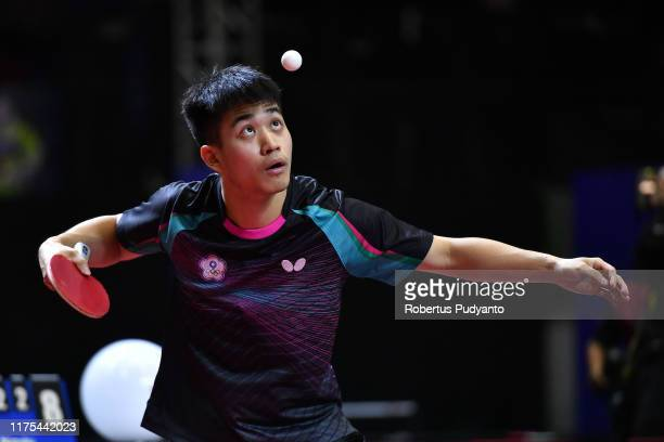 Liao Cheng-Ting of Chinese Taipei competes against Jeoung Youngsik of Korea during Men's Team semi-final match on day four of the ITTF-Asian Table...