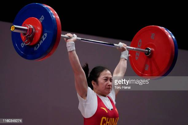Liao Qiuyun of China competes in the women's 55kg weightlifting on day one of the Ready Steady Tokyo - Weightlifting, Tokyo 2020 Olympic Games test...