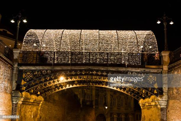 liar's bridge illuminated at night at christmas in sibiu, transylvania, romania - sibiu stock photos and pictures
