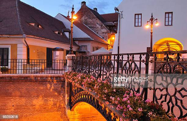 liar's bridge in sibiu at dusk - sibiu stock photos and pictures