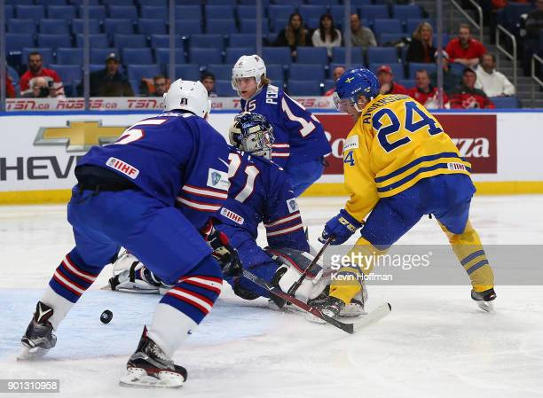 Lias Andersson of Sweden scores on Joseph Woll of United States in the third period during the IIHF World Junior Championship at KeyBank Center on...