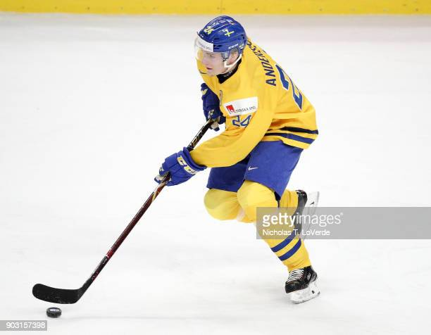 Lias Andersson of Sweden skates the puck against the United States during the first period of play in the IIHF World Junior Championships Semifinal...