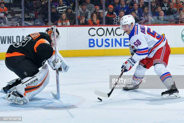 Lias Andersson of the New York Rangers goes one on one against Calvin Pickard of the Philadelphia Flyers at Wells Fargo Center on November 23 2018 in...