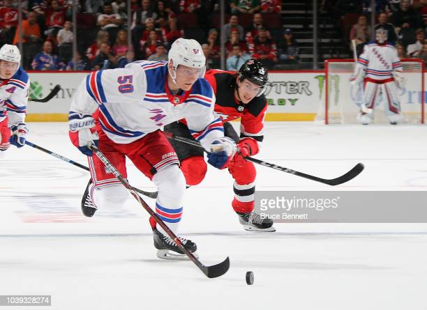 Kevin Rooney of the New Jersey Devils skates against the New York Rangers during a preseason game at the Prudential Center on September 17 2018 in...