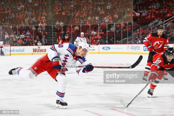 Lias Andersson of the New York Rangers takes a slapshot against the New Jersey Devils during the first period at the Prudential Center on September...