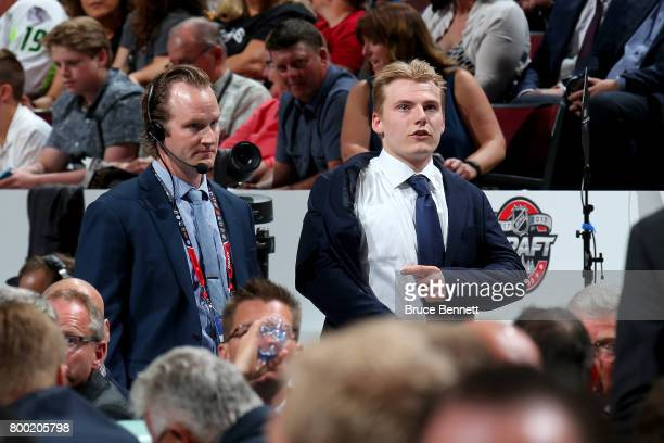 Lias Andersson walks to the stage after being selected seventh overall by the New York Rangers during the 2017 NHL Draft at the United Center on June...